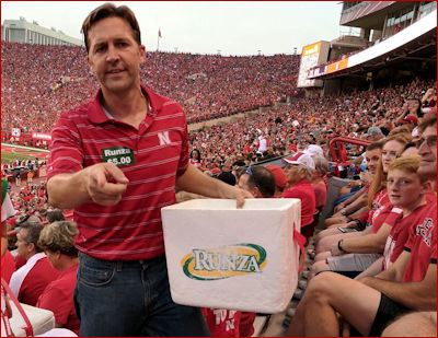 Ben Sasse sells Runzas at a Cornhuskers game.