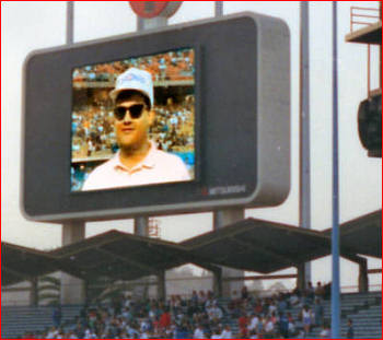 PyroManiac (sans beard) on Dodger Diamondvision. Note fearless display of Chicago Cubs' hat.