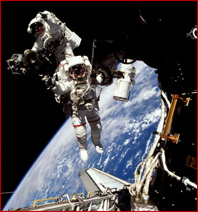 Jeff Williamsn (foreground) and Jim Voss walked in space for nearly seven hours